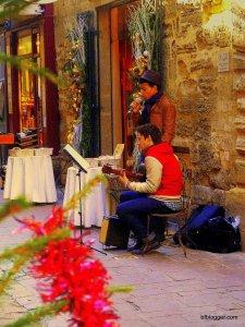 Musicians caroling on the sidewalks help create a oldtime holiday mood