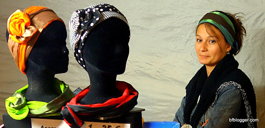 Handmade head dresses are modeled by beautiful young women.