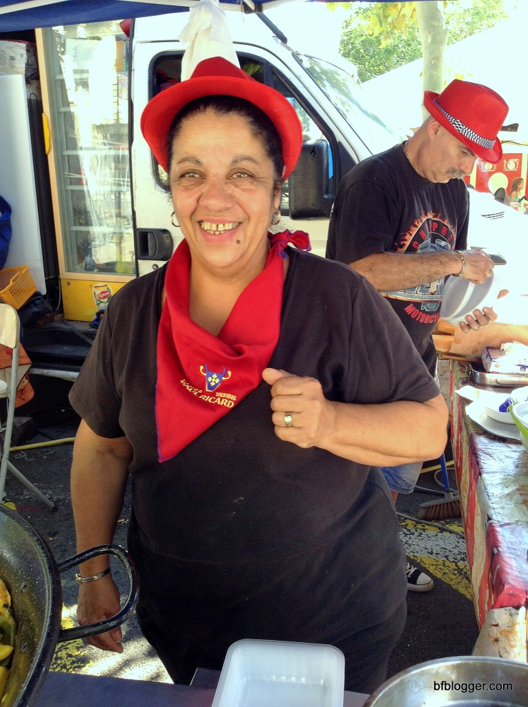 This happy vendor was dishing out her special paella ... and proud to do it.