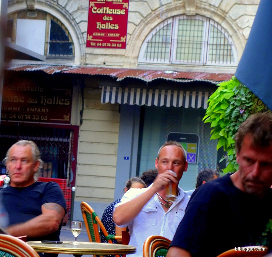 Handsome French men in   sidewalk cafes