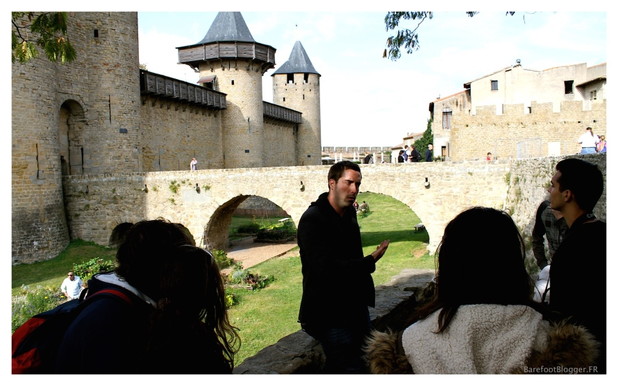 Tour guide at Carcassonne tells stories of advancing enemy troops and the rigor of the fortifications