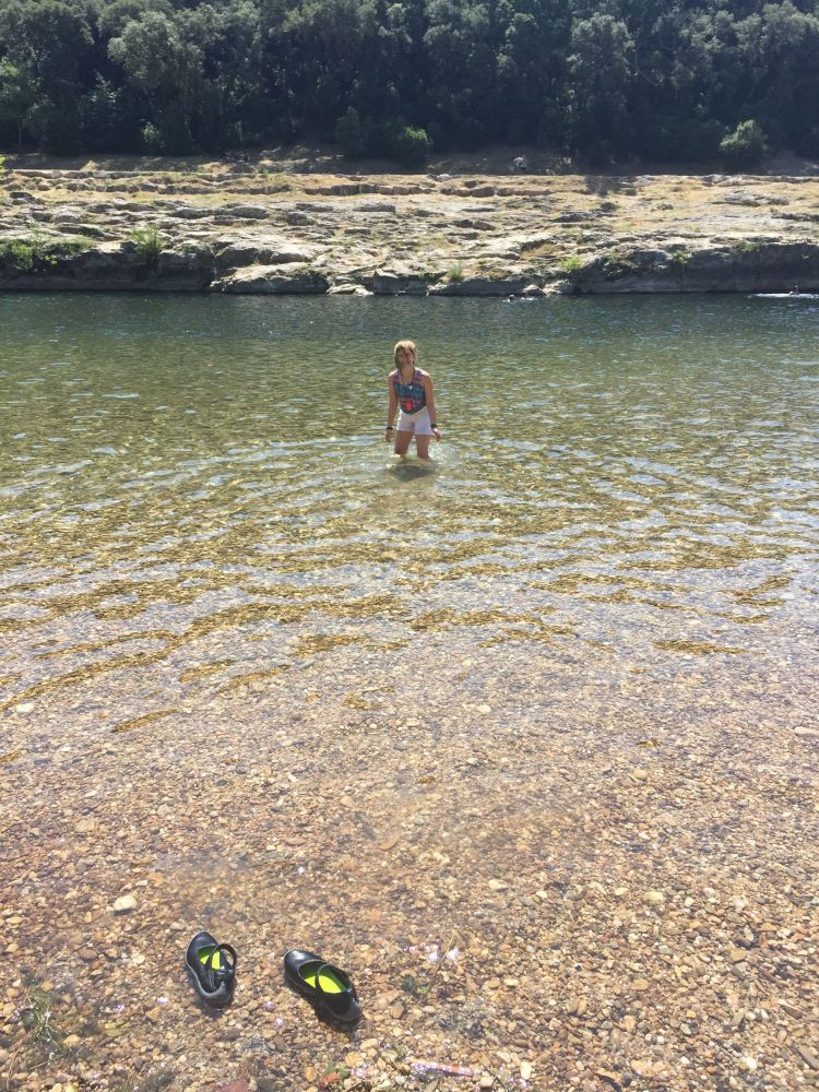 Wading in the river of the Pont du Gard