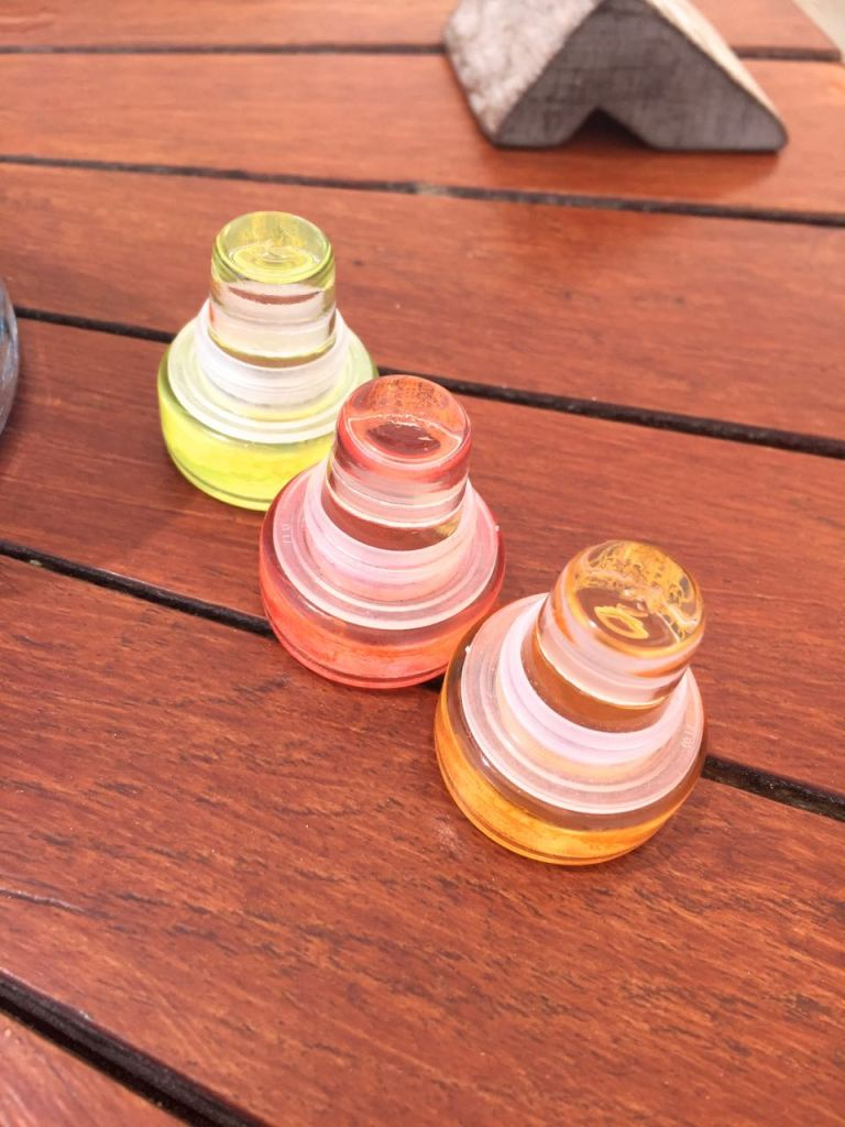 Glass wine stoppers come in a variety of colors for collectors
