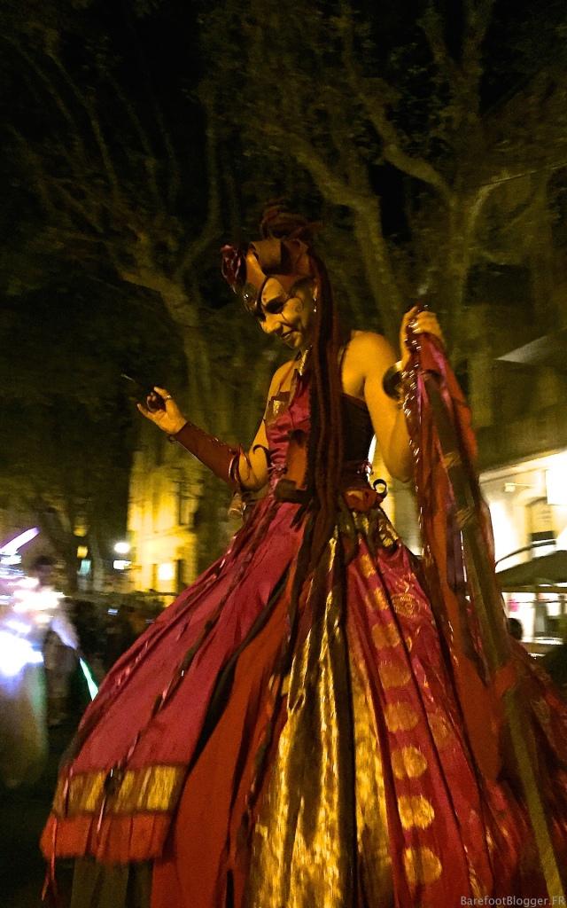 Costumed ladies on stilts for Uzes Fete Votive 2016